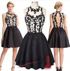 Vel. 32.- Černobílé koktejlové šaty s krajkou
