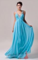Modré plesové šaty s hlubokým výstřihem.